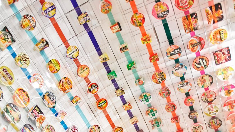 Successive generations of products hover above your head and surround you in this homage to instant noodles' march of time.